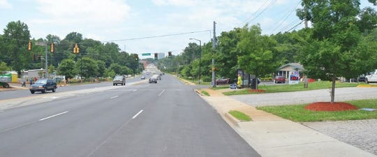 Wade Hampton Boulevard at the intersection with Chick Springs Road today.