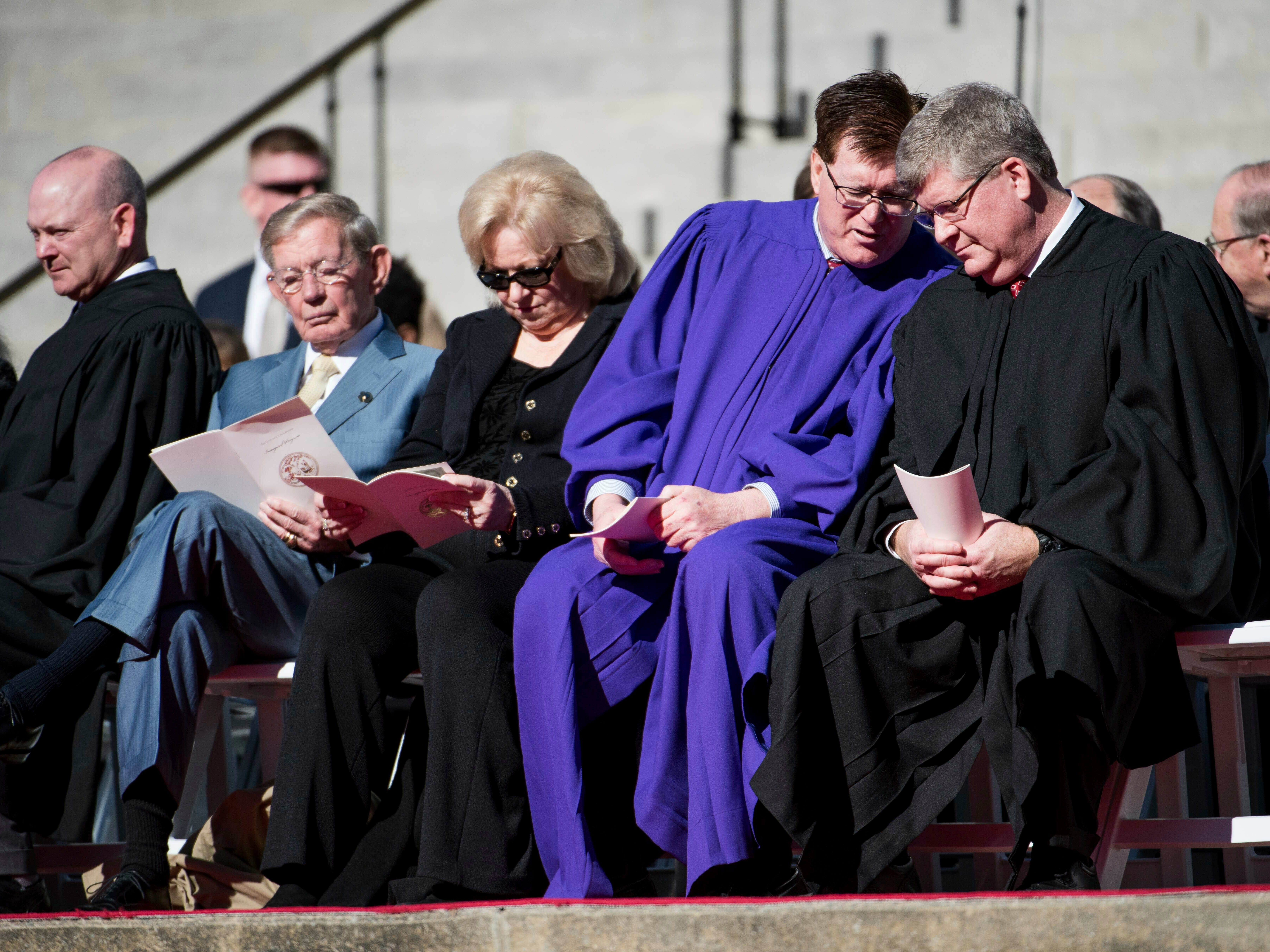South Carolina House of Representatives Clerk Charles Reid, right, listens to Rep. Jay Lucas, R-Darlington, as Sen. Hugh Leatherman, R-Florence, second from left, and his wife, Jean Leatherman, sit nearby during inauguration ceremonies for Governor Henry McMaster at the South Carolina Statehouse, Wednesday, Jan. 9, 2019, in Columbia, S.C. (AP Photo/Sean Rayford)