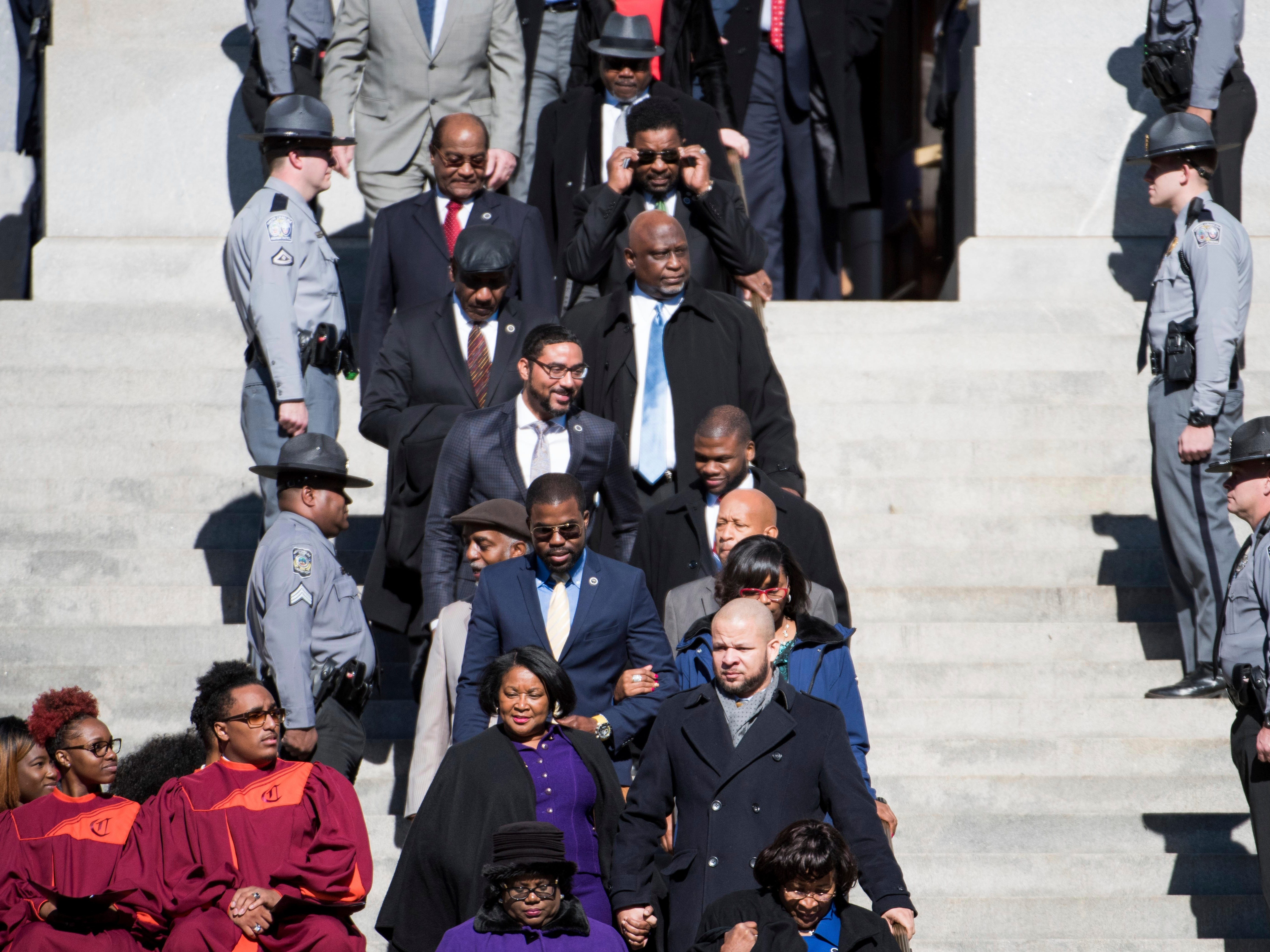 South Carolina House Democrats walk down the steps at the statehouse during inauguration ceremonies for Governor Henry McMaster, Wednesday, Jan. 9, 2019, in Columbia, S.C. (AP Photo/Sean Rayford)