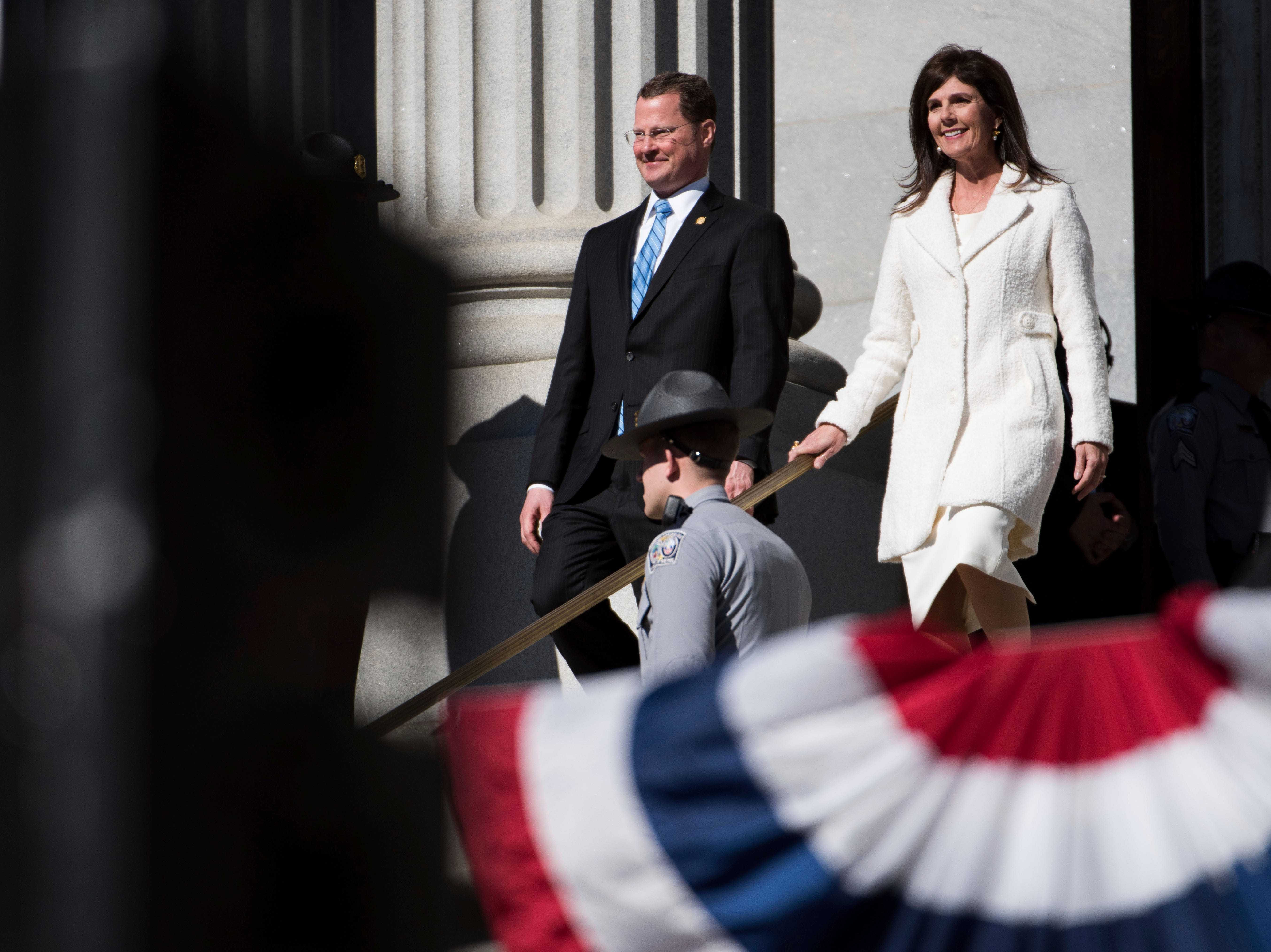 Outgoing South Carolina Lt. Governor, Kevin Bryant, left, walks down the steps with incoming Lt. Governor Pamela Evette during inauguration ceremonies for Governor Henry McMaster at the South Carolina Statehouse, Wednesday, Jan. 9, 2019, in Columbia, S.C. (AP Photo/Sean Rayford)
