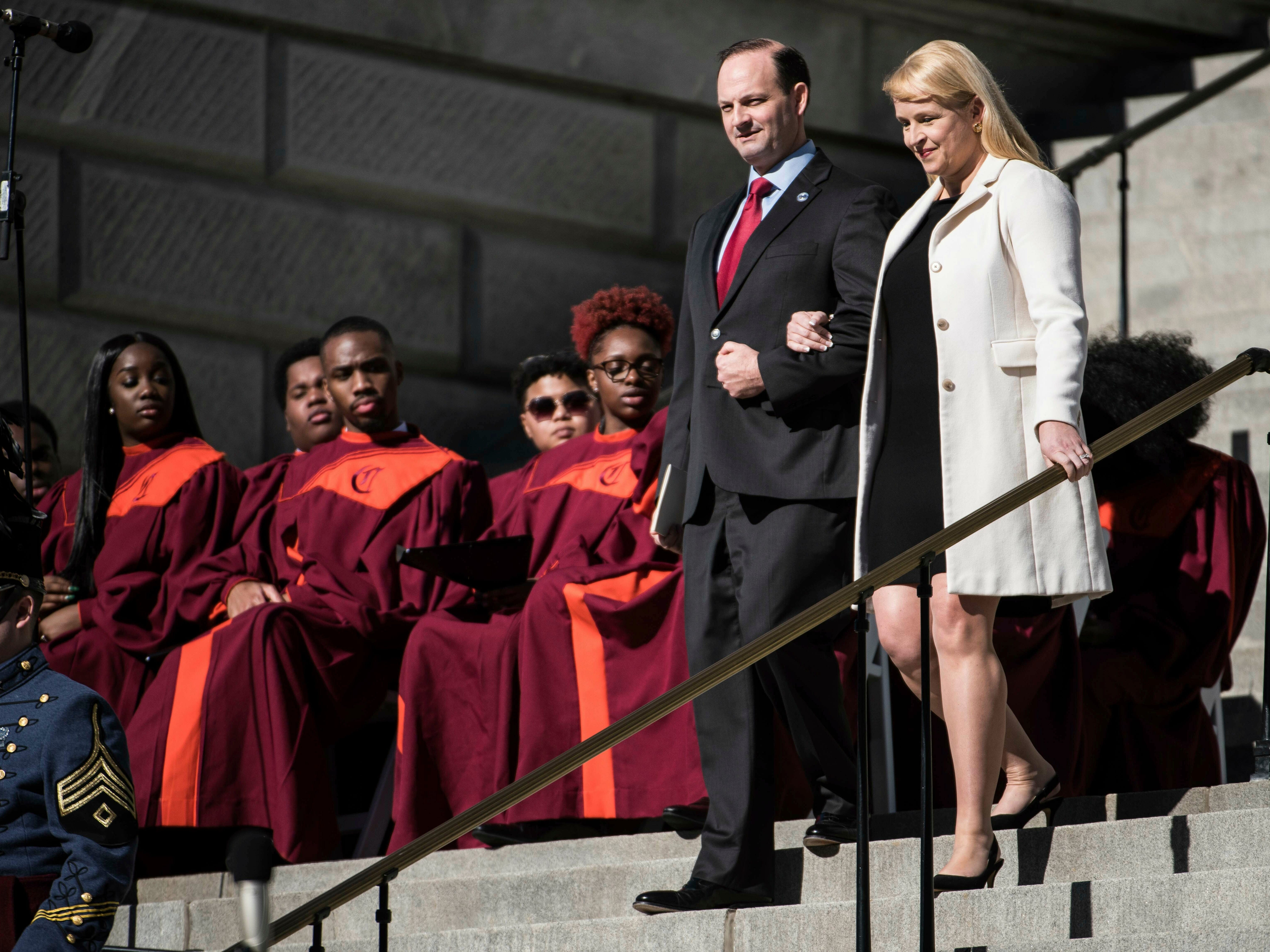 South Carolina Attorney General Alan Wilson, left, and his wife, Jennifer Wilson, walk down steps during inauguration ceremonies for Governor Henry McMaster at the South Carolina Statehouse, Wednesday, Jan. 9, 2019, in Columbia, S.C. (AP Photo/Sean Rayford)