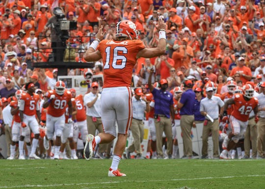 Clemson quarterback Trevor Lawrence (16) reacts after throwing his first career touchdown to Clemson wide receiver Diondre Overton (14) against Furman during the second quarter in Memorial Stadium in Clemson on September 1.