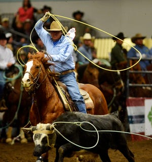 Cut Bank's Dustin Bird, pictured at the Montana Pro Rodeo Circuit Finals last January in Great Falls, was a winner in team roping at the 59th Belt PRCA Rodeo this weekend.