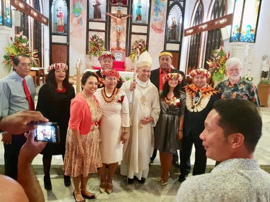 Visiting Guam Gov. Lou Leon Guerrero joins CNMI Gov. Ralph Torres, Bishop Ryan Jimenez and other elected officials during Sunday's inaugural mass on Saipan. Torres took his oath of office on Monday, along with other elected CNMI officials.