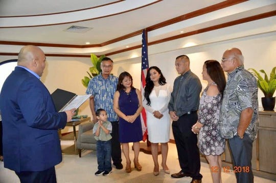 Acting Governor Acting Gov. Josh Tenorio, left, officiates his first civil wedding at Adelup, for Anthony Raymond Arriola Deleon Guerrero and Vanity Tudela Sablan. Former CNMI Gov. Juan N. Babauta and wife are the parents of the bride.