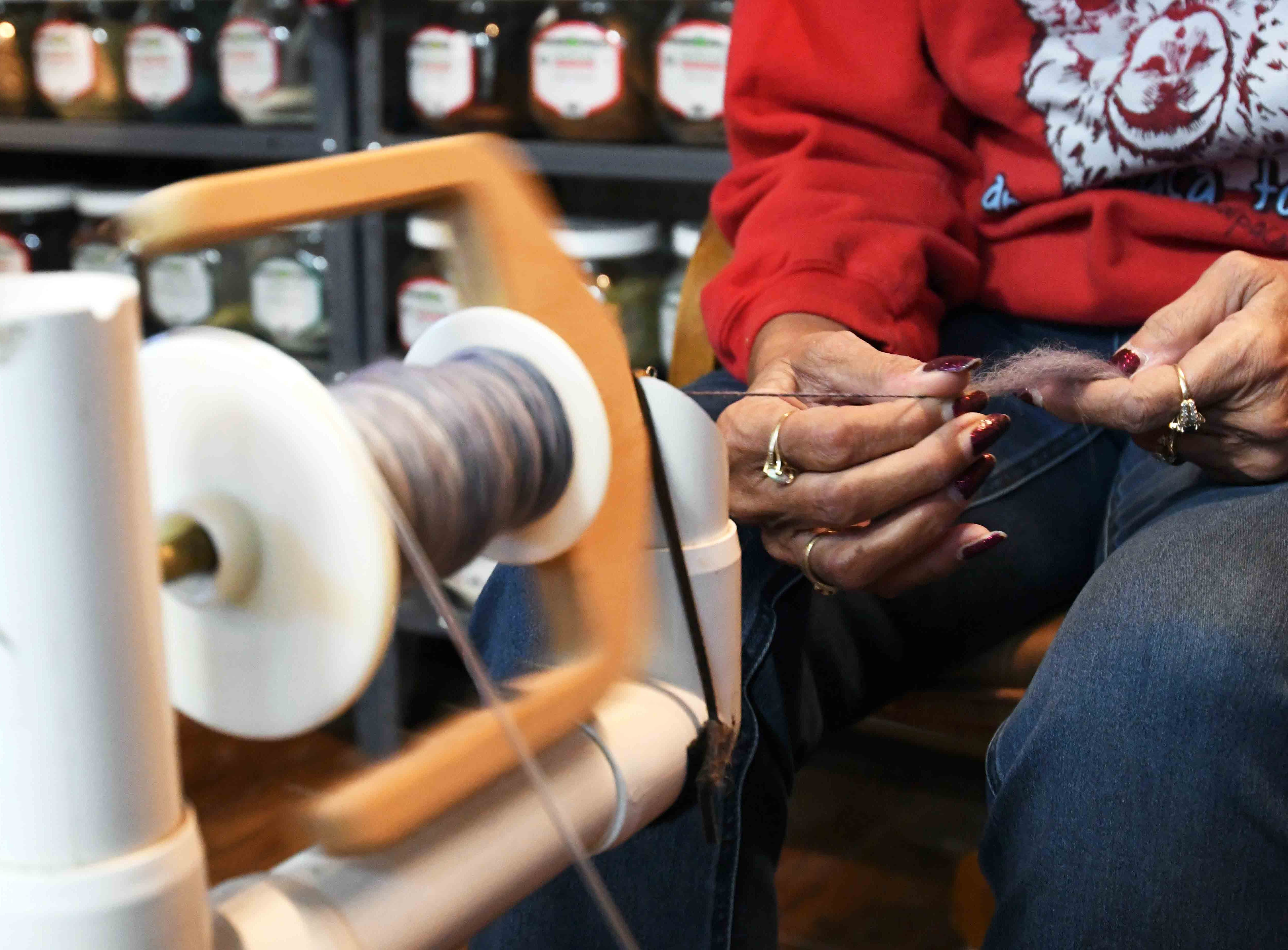 Mary Ann Stroka demonstrates how to spin wool at her shop at A Stroka-Gene-Us Alpaca Farm in Stringer, Mississippi.