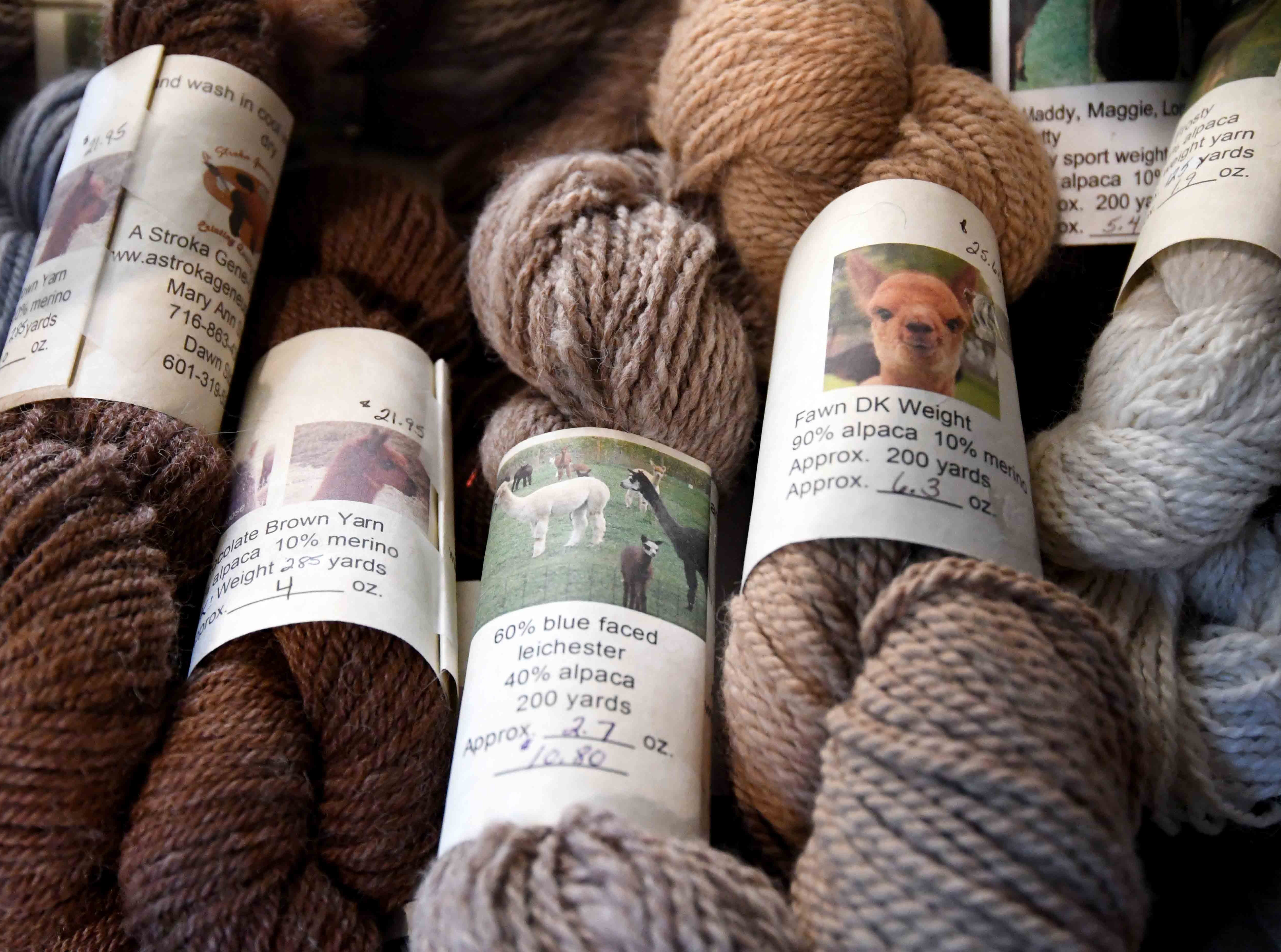 Mary Ann Stroka sells alpaca yarn at her shop. The yarn is labeled with the name and of the alpaca.