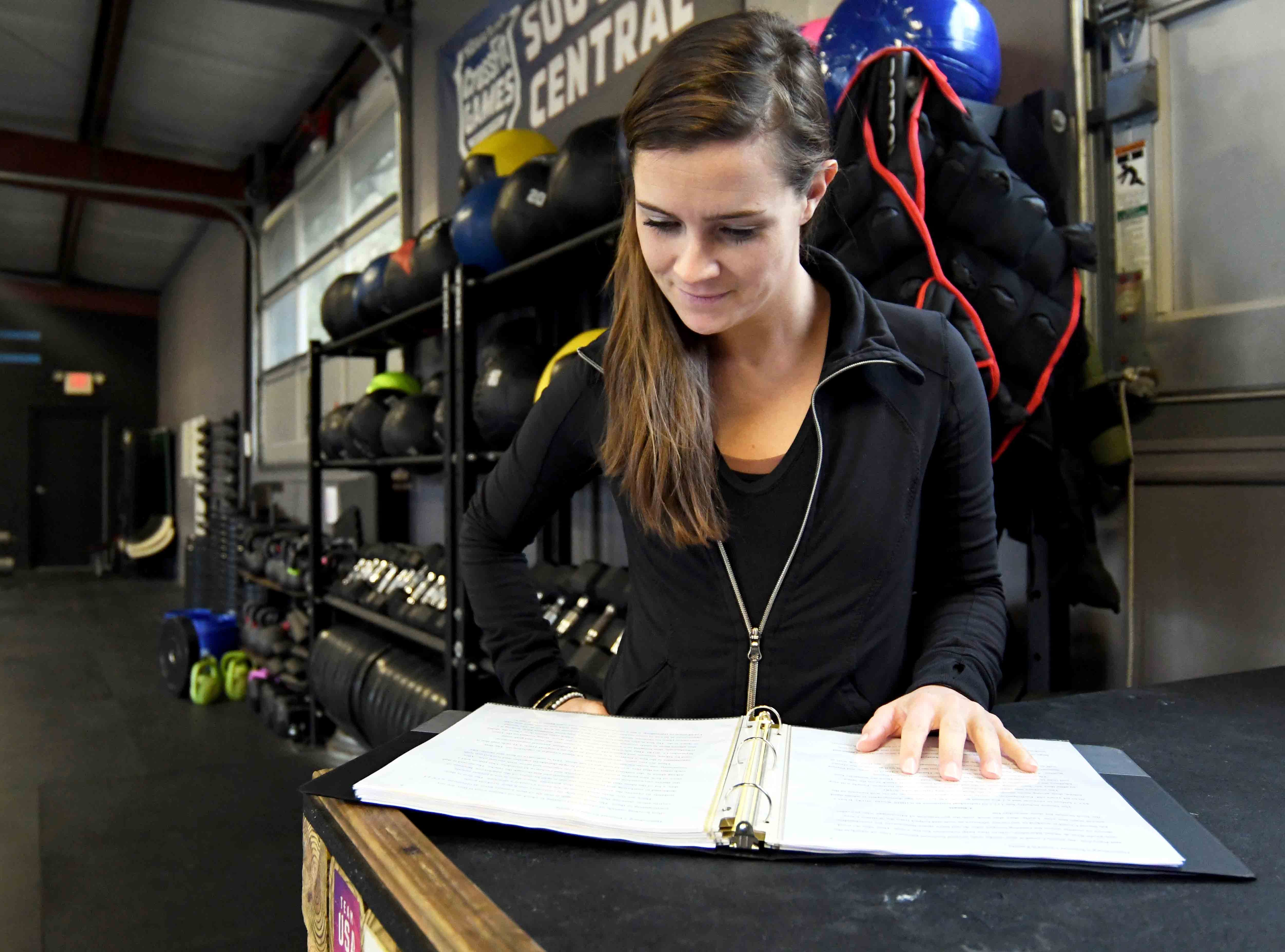 Manager Meghan Fisher shows how the University of Southern Mississippi School of Marketing students provided solutions to problems for real-life clients like Fourth Street Crossfit in Hattiesburg.