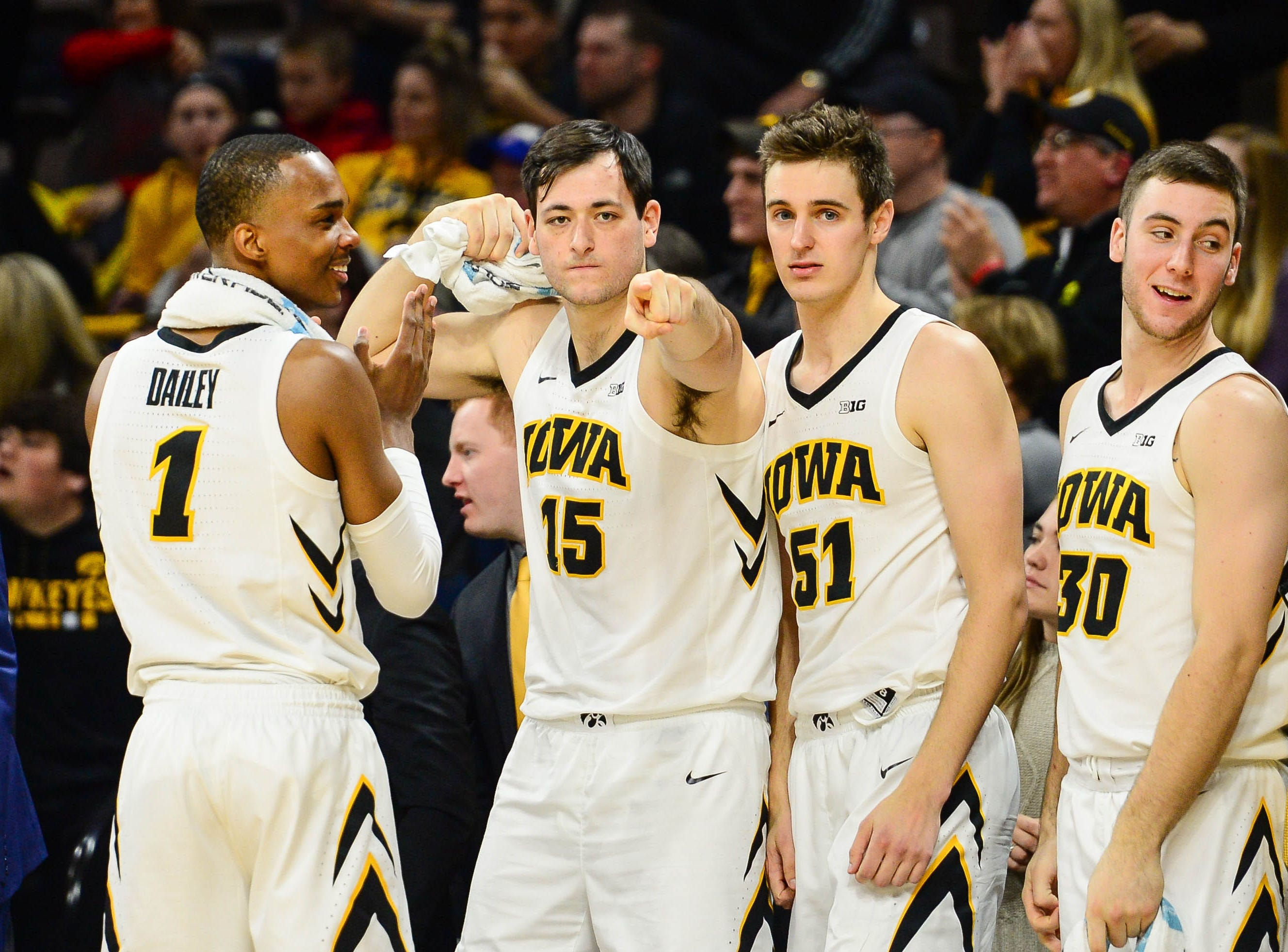 Iowa Hawkeyes guard Maishe Dailey (1) and forward Ryan Kriener (15) and forward Nicholas Baer (51) and guard Connor McCaffery (30) react during the second half against the Ohio State Buckeyes at Carver-Hawkeye Arena.