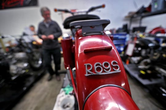 Mike Hubert works on restoring a 1969 BMW motorcycle at Hoy Vintage Cycles.