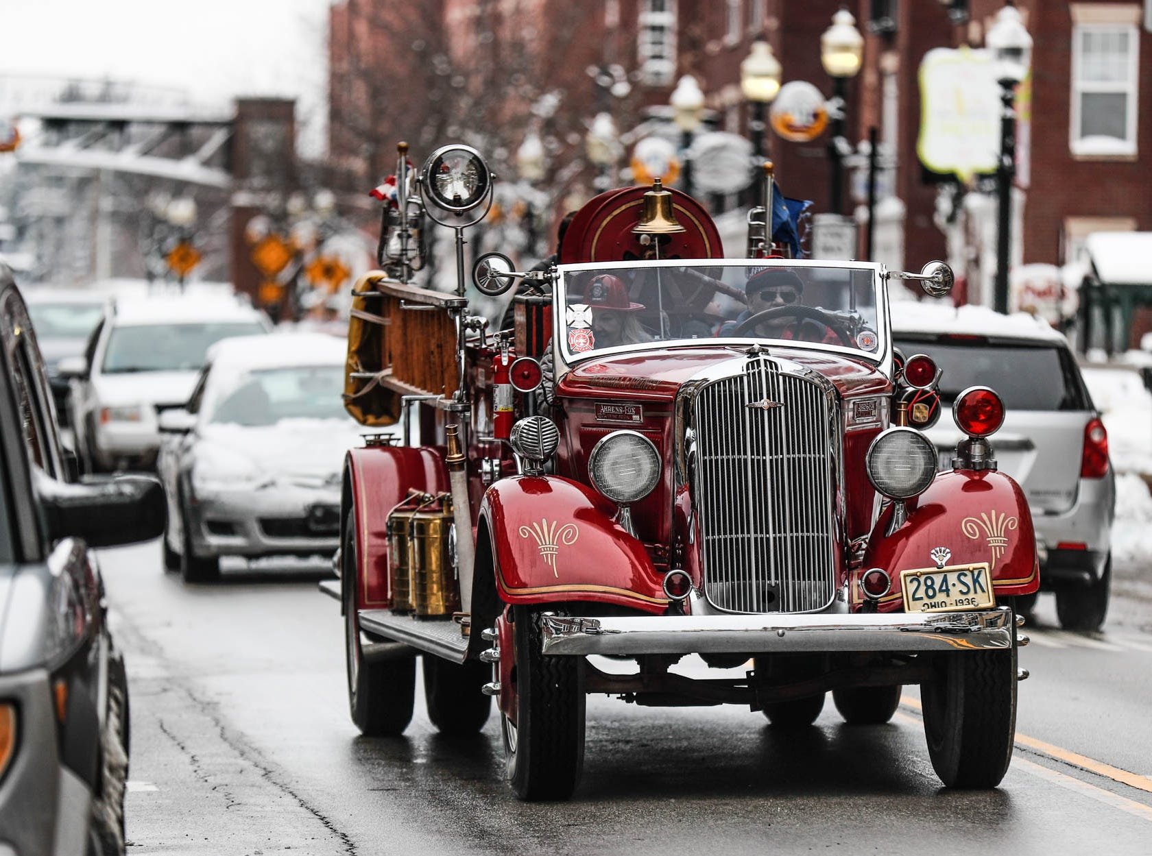 A antique fire engine drives through downtown Carmel Ind. on Sunday, Jan. 13, 2019.