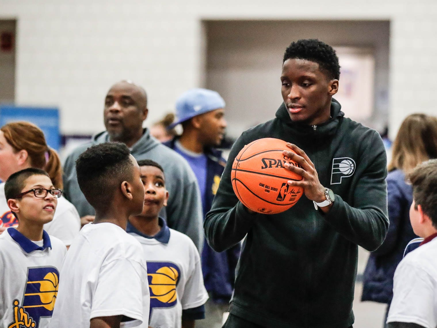Indiana Pacers guard Victor Oladipo helps children learn the game of basketball after surprising then with an appearance during a Jr. Pacers Clinic at Concord Neighborhood Center, on Monday, Jan. 14, 2019.