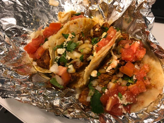 Al pastor tacos from Dos Hombres Taco House
