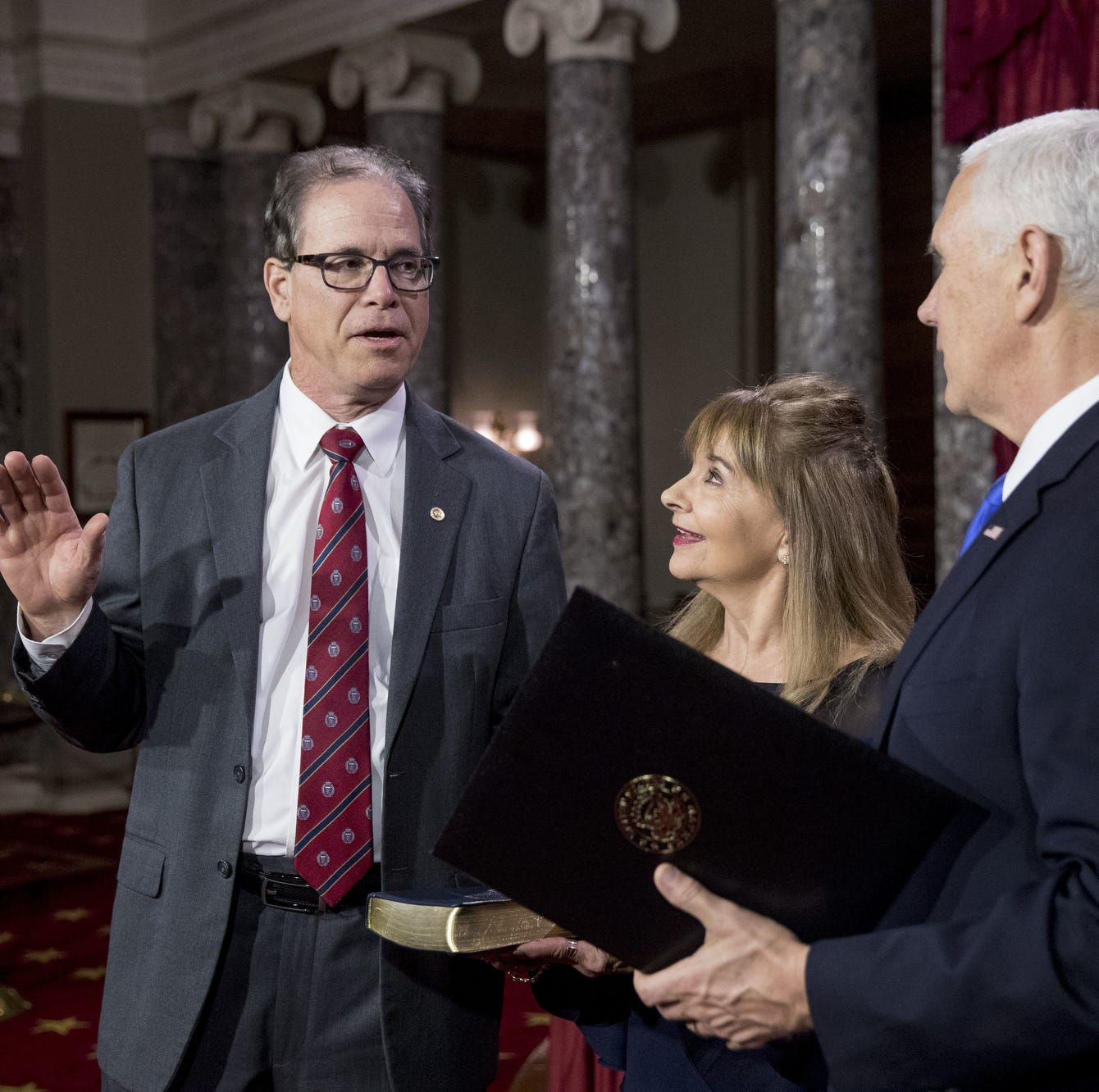 Vice President Mike Pence administers the Senate oath of office to Sen. Mike Braun, R-Ind., accompanied by his wife Maureen during a mock swearing-in ceremony in the Old Senate Chamber on Capitol Hill in Washington, D.C., Thursday, Jan. 3, 2019, as the 116th Congress begins.