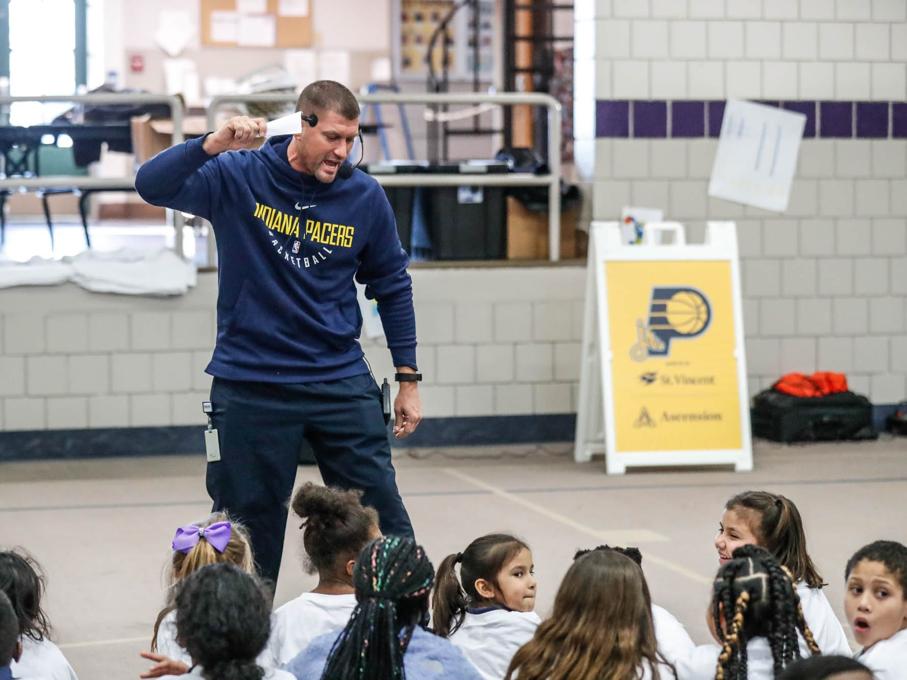 Indiana Pacers Associate Director of Community Relations, Richie Smith, pumps up kids for a surprise visit by Indiana Pacers guard Victor Oladipo during a Jr. Pacers Clinic at Concord Neighborhood Center, on Monday, Jan. 14, 2019.