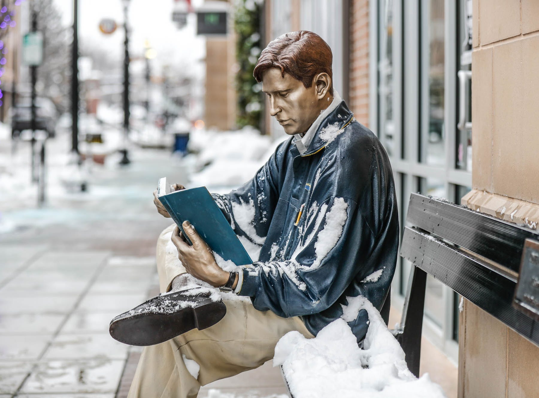 A sculpture by J. Seaward Johnson is dusted with snow in downtown Carmel Ind. on Sunday, Jan. 13, 2019.