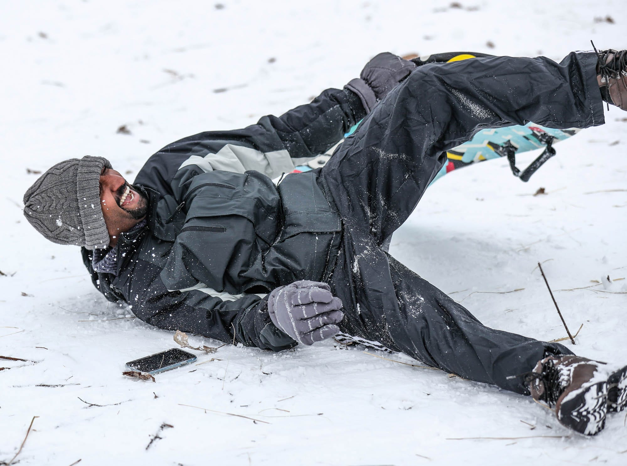 Kesh Patel crashes while zooming down the sledding hill at West Park in Carmel Ind. on Sunday, Jan. 13, 2019.