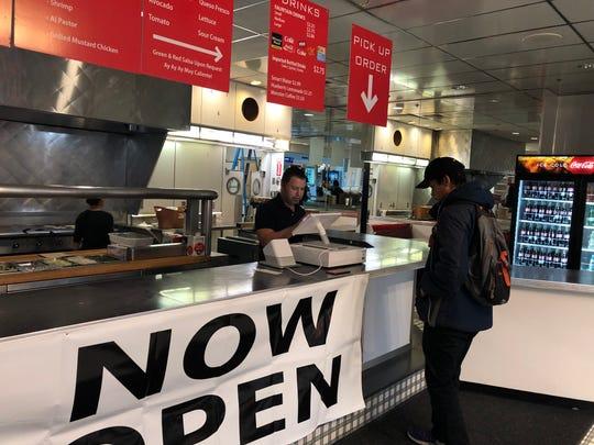 Pedro Gracia takes a customer's order at Dos Hombre Taco House