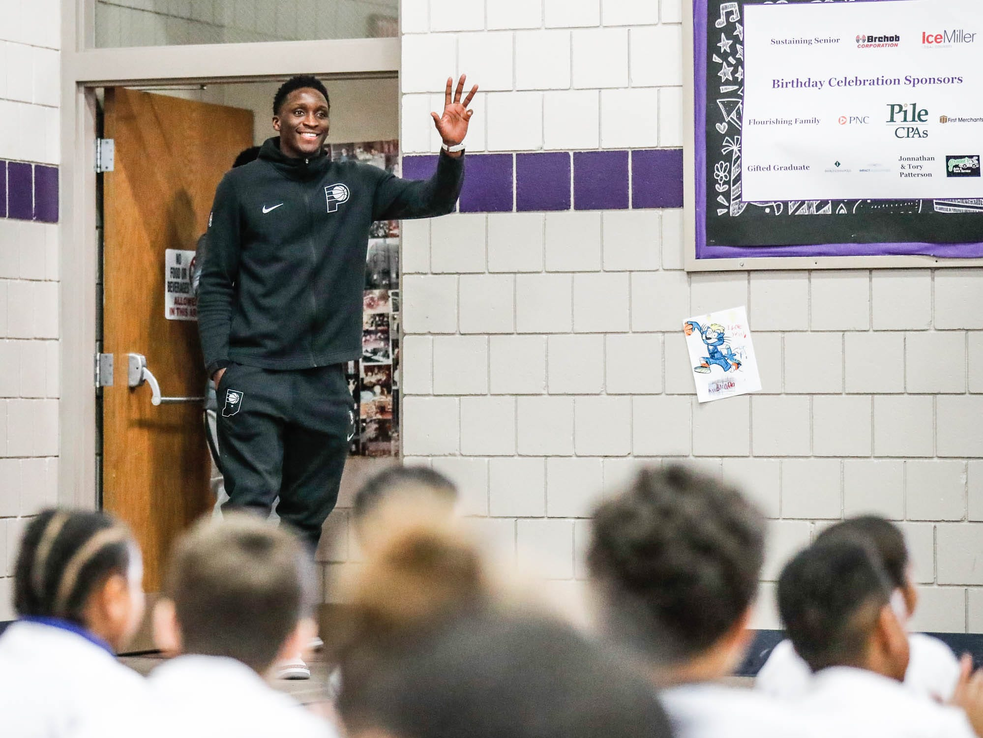 Indiana Pacers guard Victor Oladipo makes a second grand entrance to surprise children taking part in a Jr. Pacers Clinic at Concord Neighborhood Center, on Monday, Jan. 14, 2019. The first entrance wasn't good enough for for Dr. Dunk who was also in attendance to run the clinic.