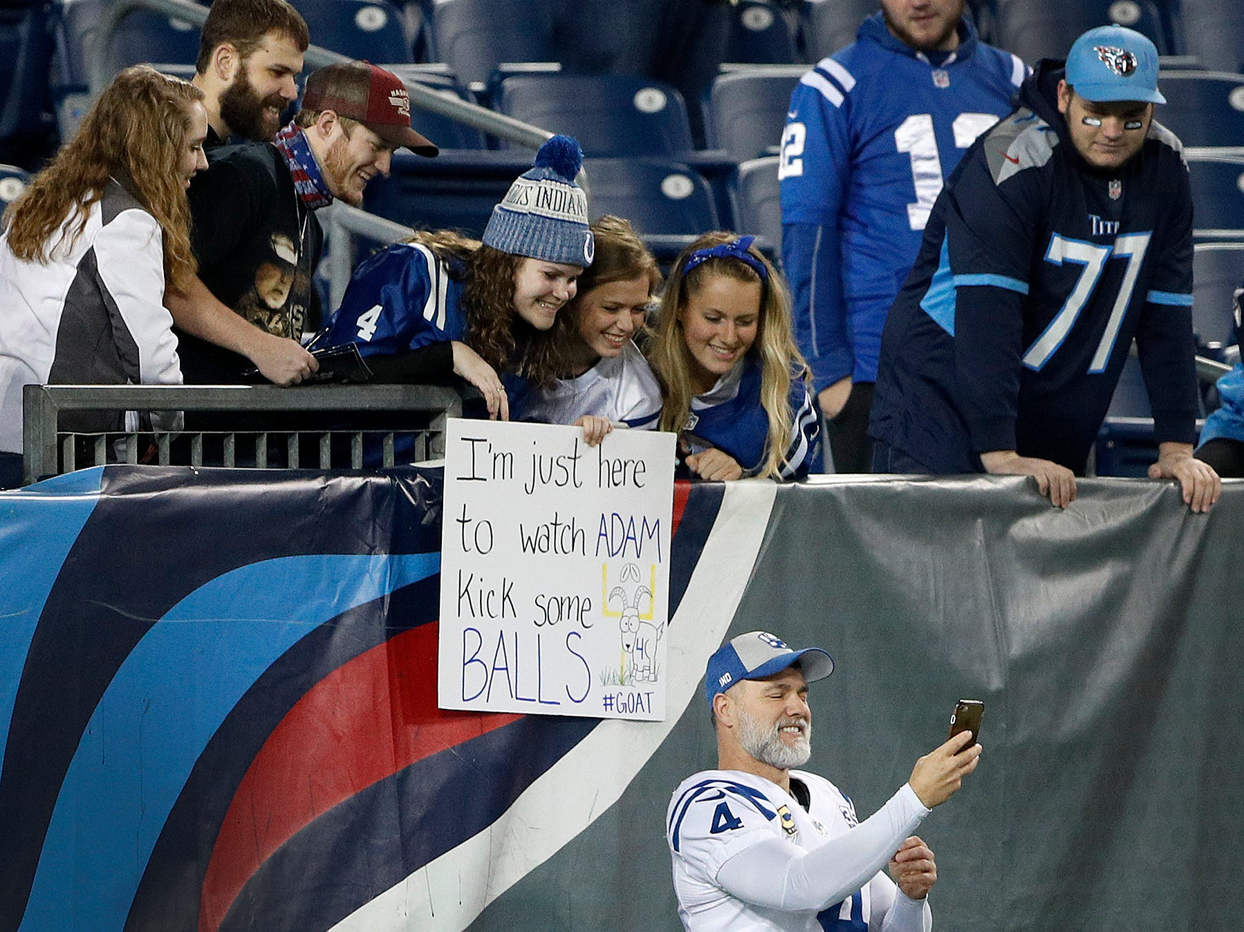 Indianapolis Colts kicker Adam Vinatieri (4) takes a selfie with some fans before the start of their game against the Tennessee Titans at Nissan Stadium in Nashville, Tenn., on Sunday, Dec. 30, 2018.