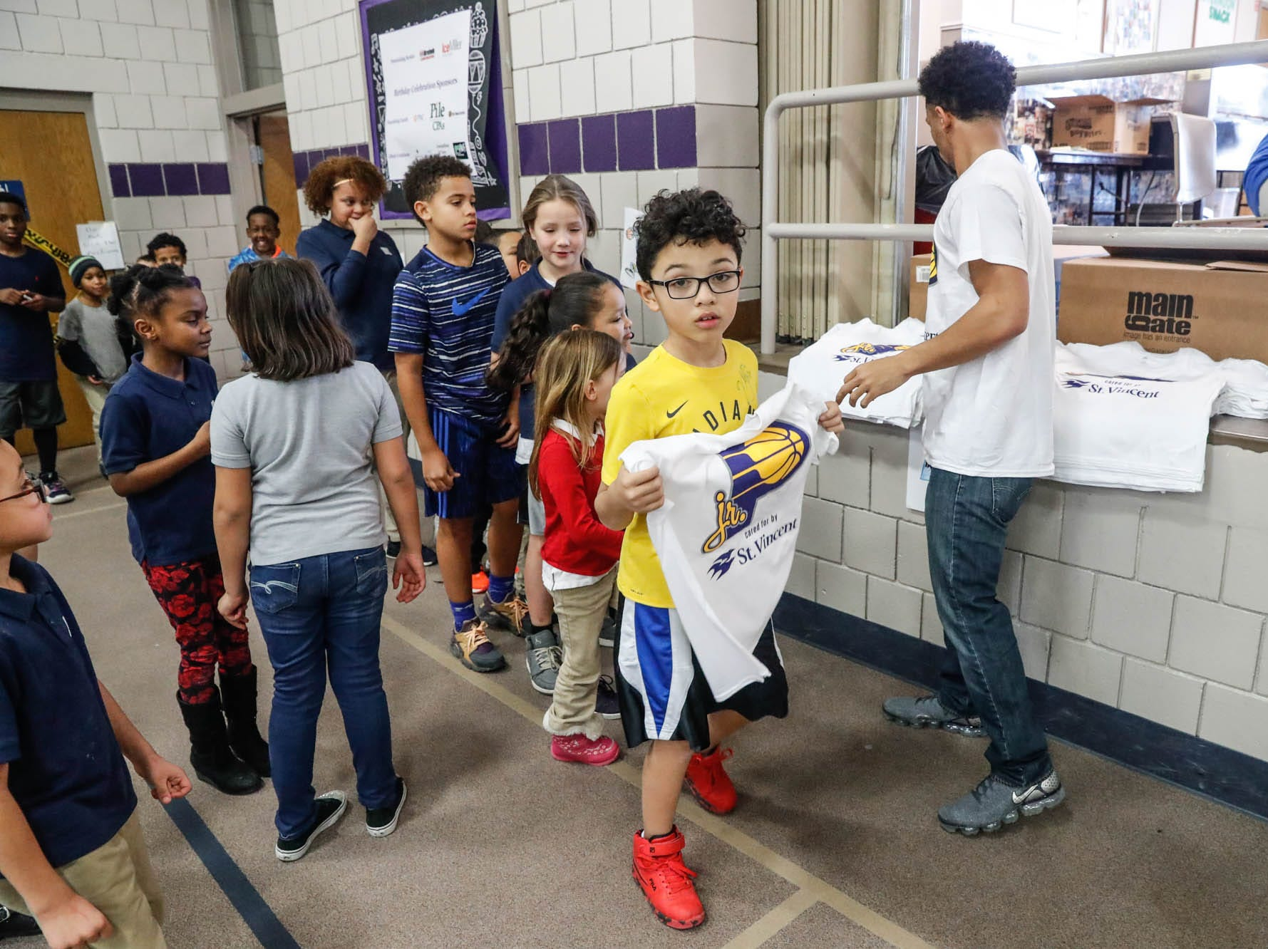 Children are given free Indiana Pacers shirts during a Jr. Pacers Clinic at Concord Neighborhood Center, on Monday, Jan. 14, 2019.