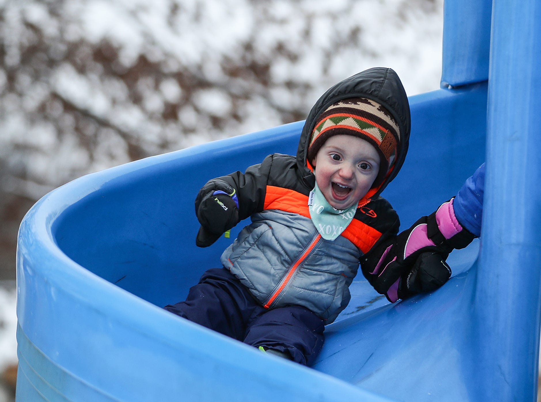 Cooper Ellis, 1, zooms down a slide at Highland Park in Indianapolis, Sunday, Jan. 13, 2019.