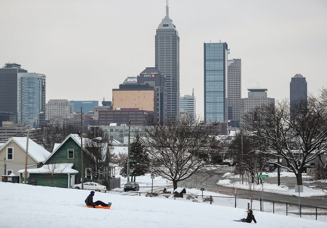 Children sled down a hill at Highland Park in Indianapolis, Sunday, Jan. 13, 2019. Saturday's storm left Indianapolis blanketed in more than 7 inches of snow.