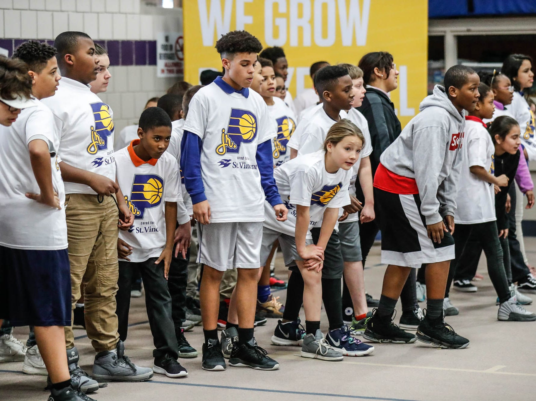 Children at Concord Neighborhood Center line up for high knees during a Jr. Indiana Pacers clinic, which included a surprise visit by Indiana Pacers guard Victor Oladipo on Monday, Jan. 14, 2019.