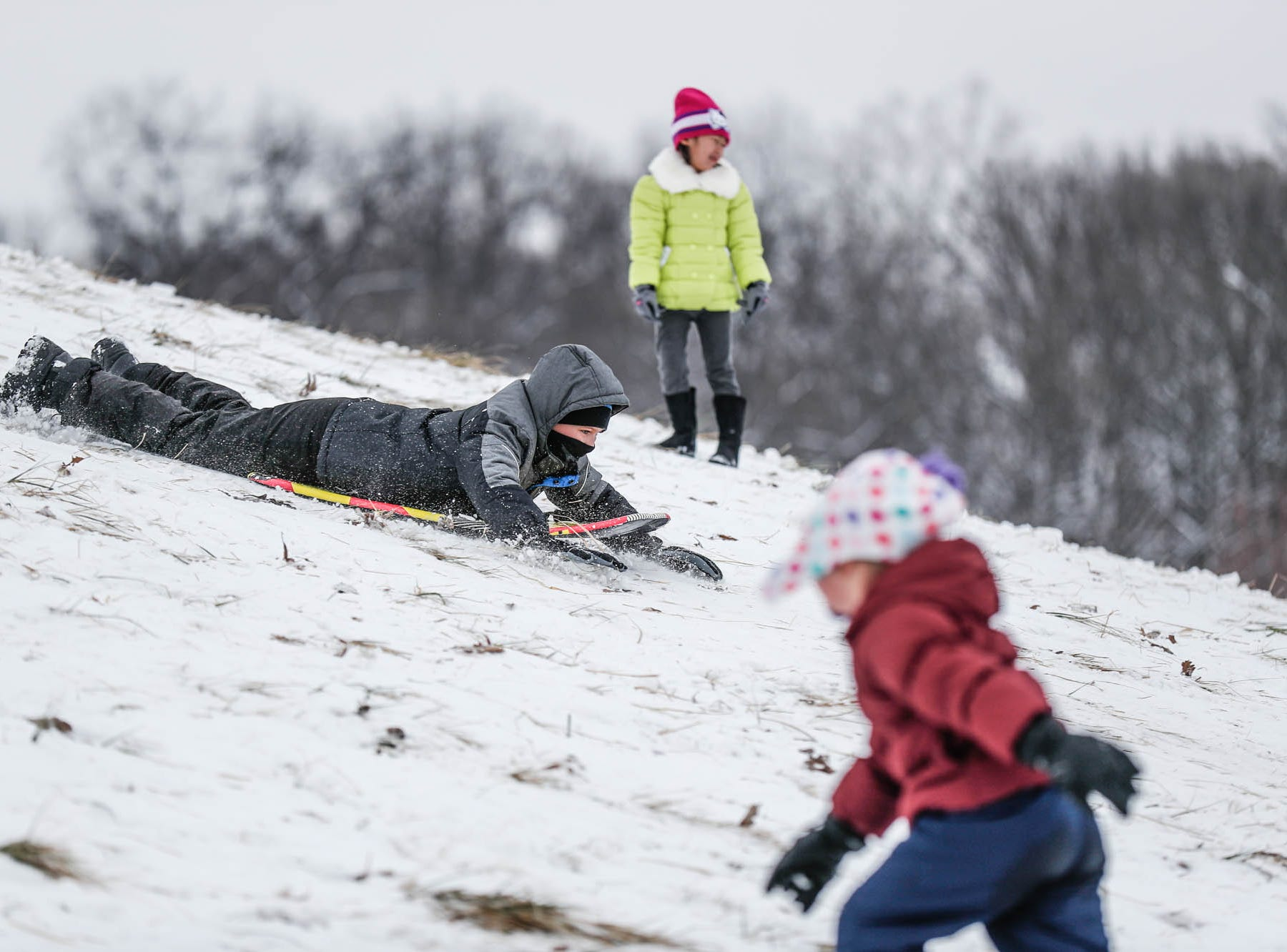 Children take to the slopes at West Park in Carmel Ind. on Sunday, Jan. 13, 2019.