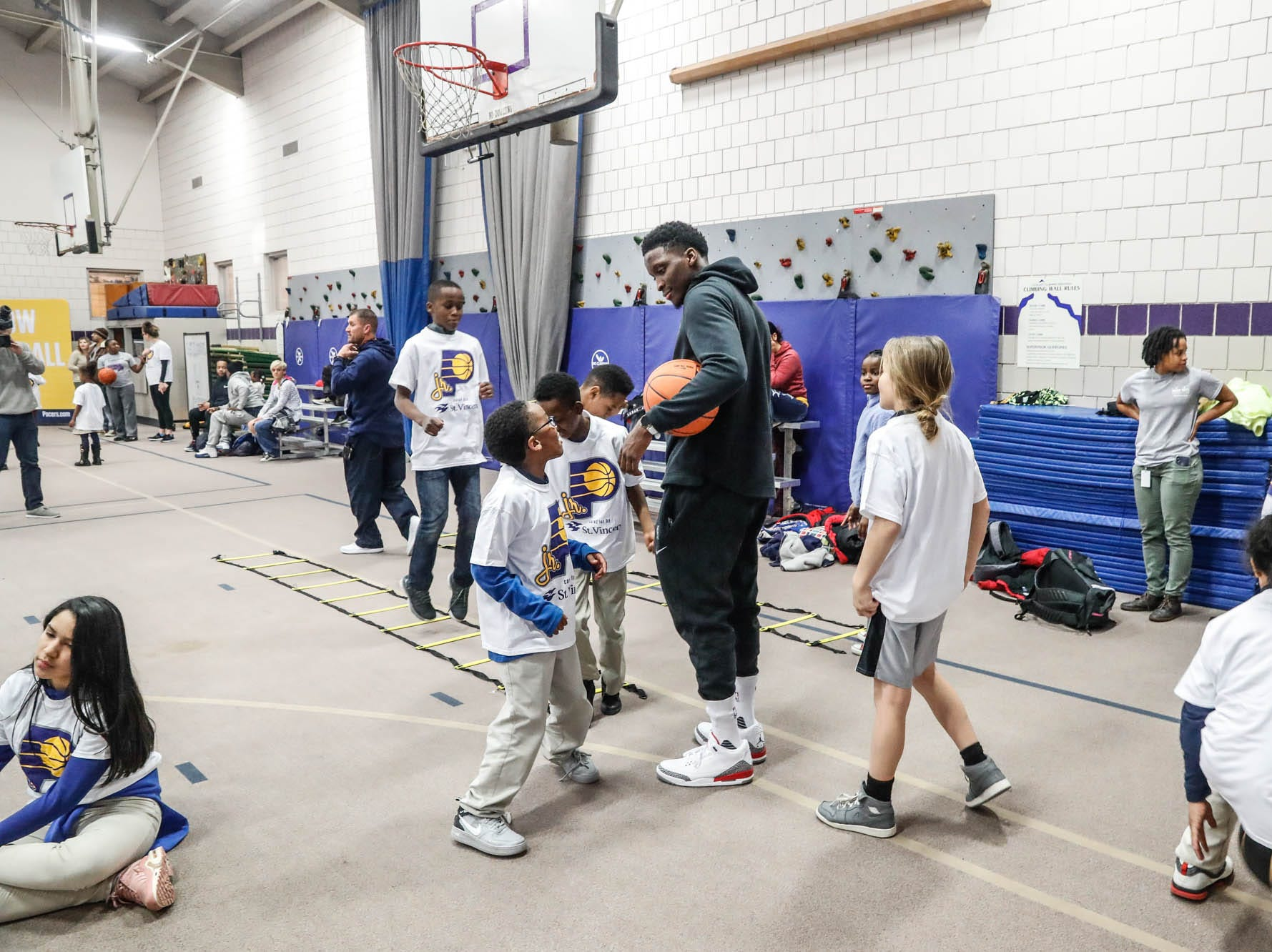 Indiana Pacers guard Victor Oladipo helps children run drills after making a surprise appearance during a Jr. Pacers Clinic at Concord Neighborhood Center, on Monday, Jan. 14, 2019.
