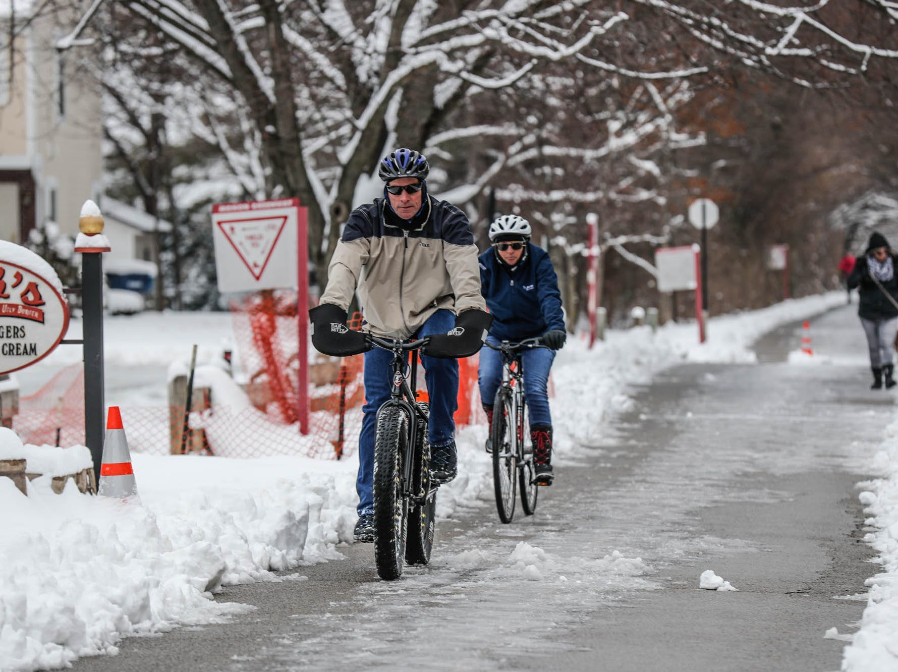 Walkers and riders take to the Monon Trail in downtown Carmel Ind. on Sunday, Jan. 13, 2019.