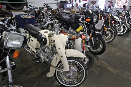 A line of motorcycles that are being fixed and restored at Hoy Vintage Cycles.