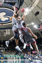 Fighting Irish guard Prentiss Hubb (3) is fouled against Boston College in the second half at the Purcell Pavilion.