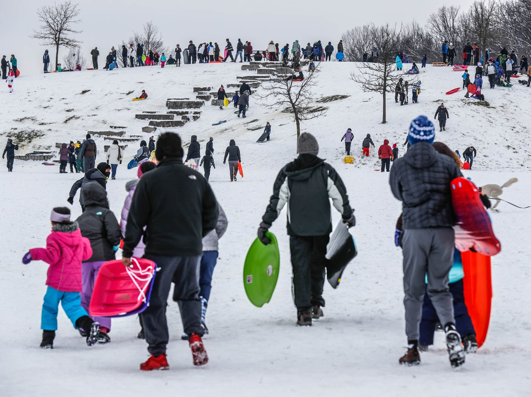 Snow lovers of all ages descend on the sledding hill at West Park in Carmel Ind. on Sunday, Jan. 13, 2019.