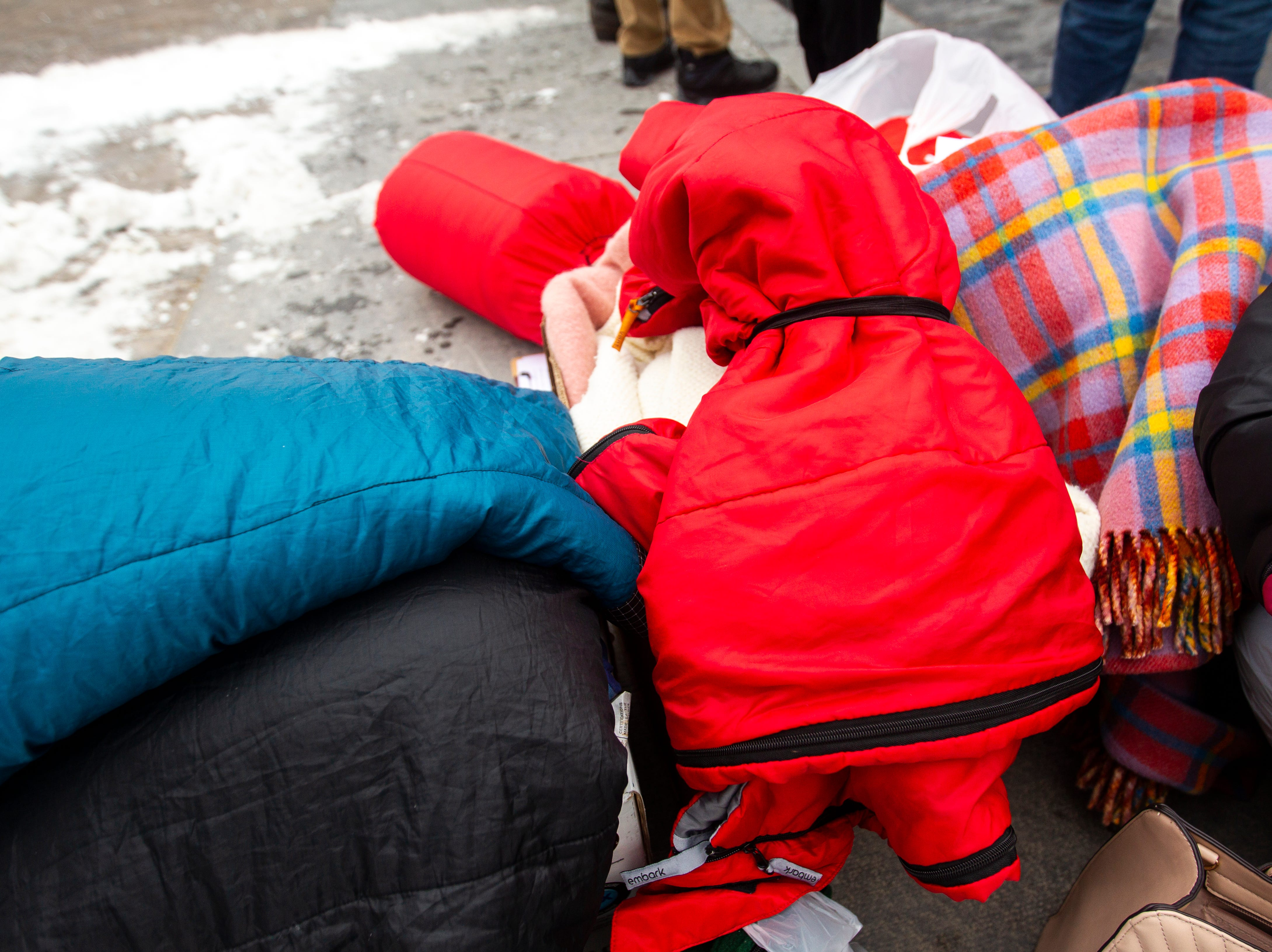 "Sleeping bags and blankets sit in a pile during the ""Sleep-In to Stop #HostileDesign"" on Monday, Jan. 14, 2019, along the pedestrian mall in downtown Iowa City, Iowa."