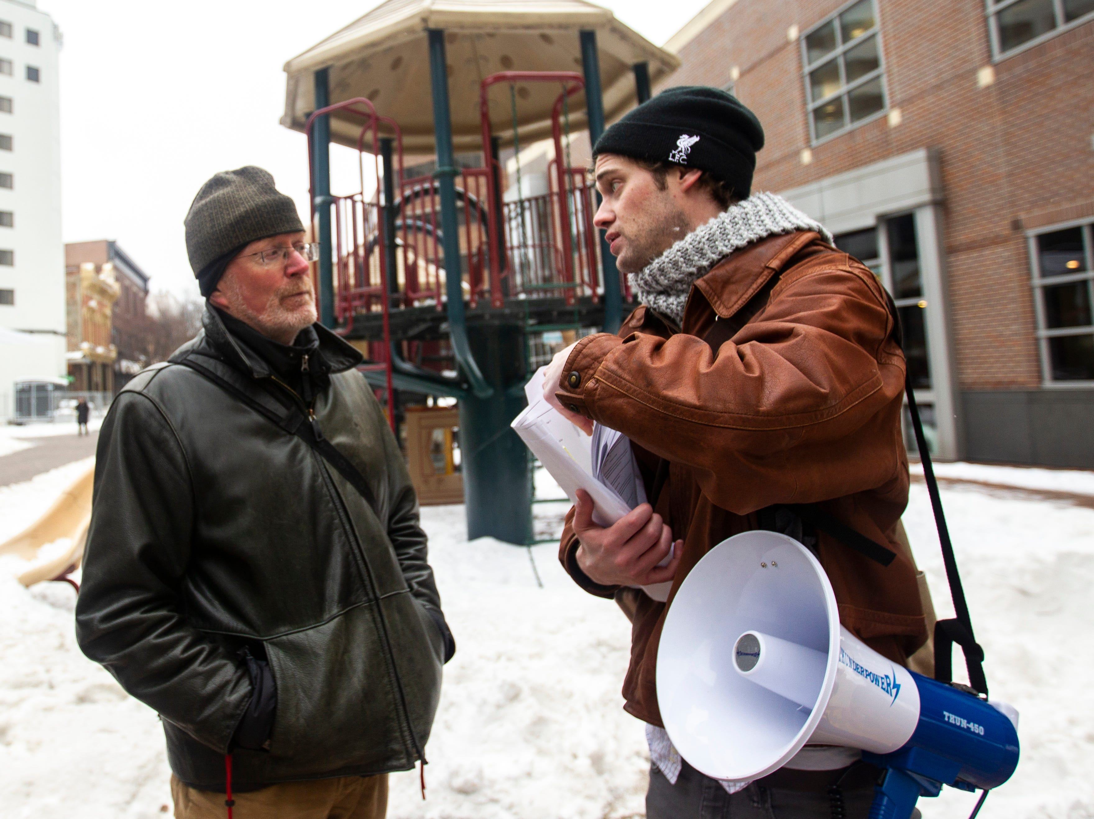 "Iowa City Mayor Jim Throgmorton, left, talks with Mark Petterson, a volunteer at the Catholic Worker House, after the ""Sleep-In to Stop #HostileDesign"" on Monday, Jan. 14, 2019, along the pedestrian mall in downtown Iowa City, Iowa."
