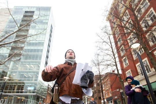 "Mark Petterson, a volunteer at the Catholic Worker House, calls out to protesters during the ""Sleep-In to Stop #HostileDesign"" on Monday, Jan. 14, 2019, along the pedestrian mall in downtown Iowa City, Iowa."