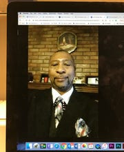 Pastor Anthony Longino is shown in this photo of a Facebook post on a computer monitor.