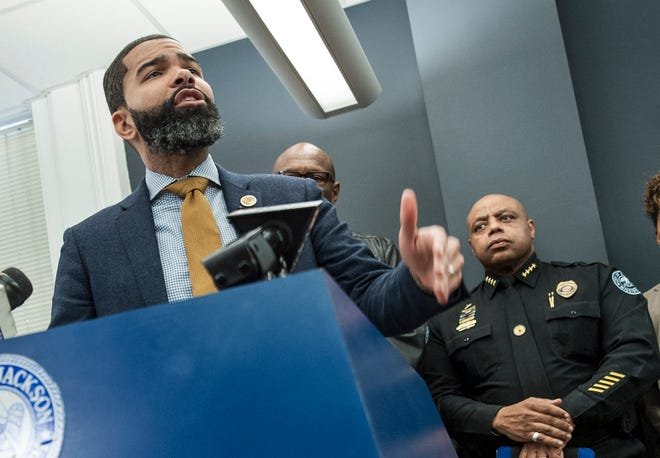 During a recent news conference to address homicide in the city, Jackson Mayor Chokwe Antar Lumumba, left, and police Chief James Davis, right, said police can't solve the problem alone. The public has to help.
