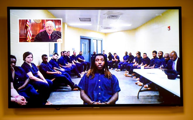 """Elijah Garrison, 25, tells Jackson City Court Judge Blake Anderson """"I'm innocent"""" over livestream during the arraignment for Garrison in connection with the first fatal shooting in Jackson in 2019 at Jackson CIty Court in Jackson, Tenn., on Monday, Jan. 14, 2019."""