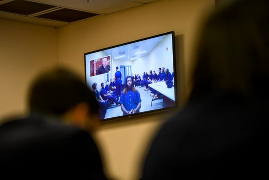 Elijah Garrison, 25, sits before a camera live streaming the arraignment for Garrison in connection with the first fatal shooting in Jackson in 2019 at Jackson CIty Court in Jackson, Tenn., on Monday, Jan. 14, 2019.