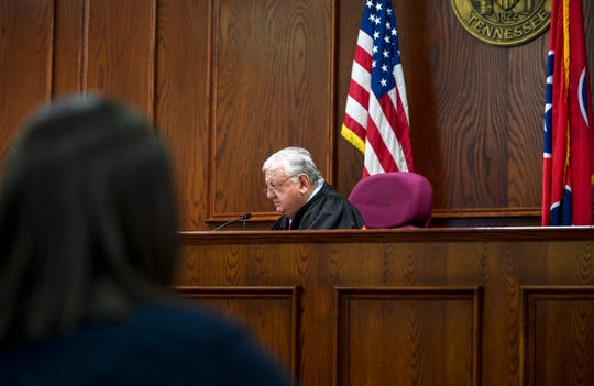Jackson City Court Judge Blake Anderson speaks into a camera live streaming the arraignment for Elijah Garrison in connection with the first fatal shooting in Jackson in 2019 at Jackson CIty Court in Jackson, Tenn., on Monday, Jan. 14, 2019.