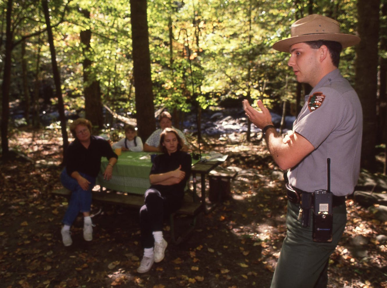 Park ranger J.D. Lee pleads with members of the Edwards family their campsite in the Elkmont campground, October, 1990.