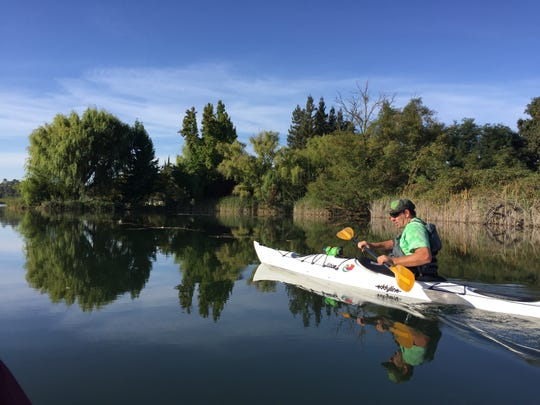 Dan Arbuckle, owner of Headwaters Kayak Shop, leads paddling excursions on Lake Lodi and the Mokelumne River in the heart of wine country.