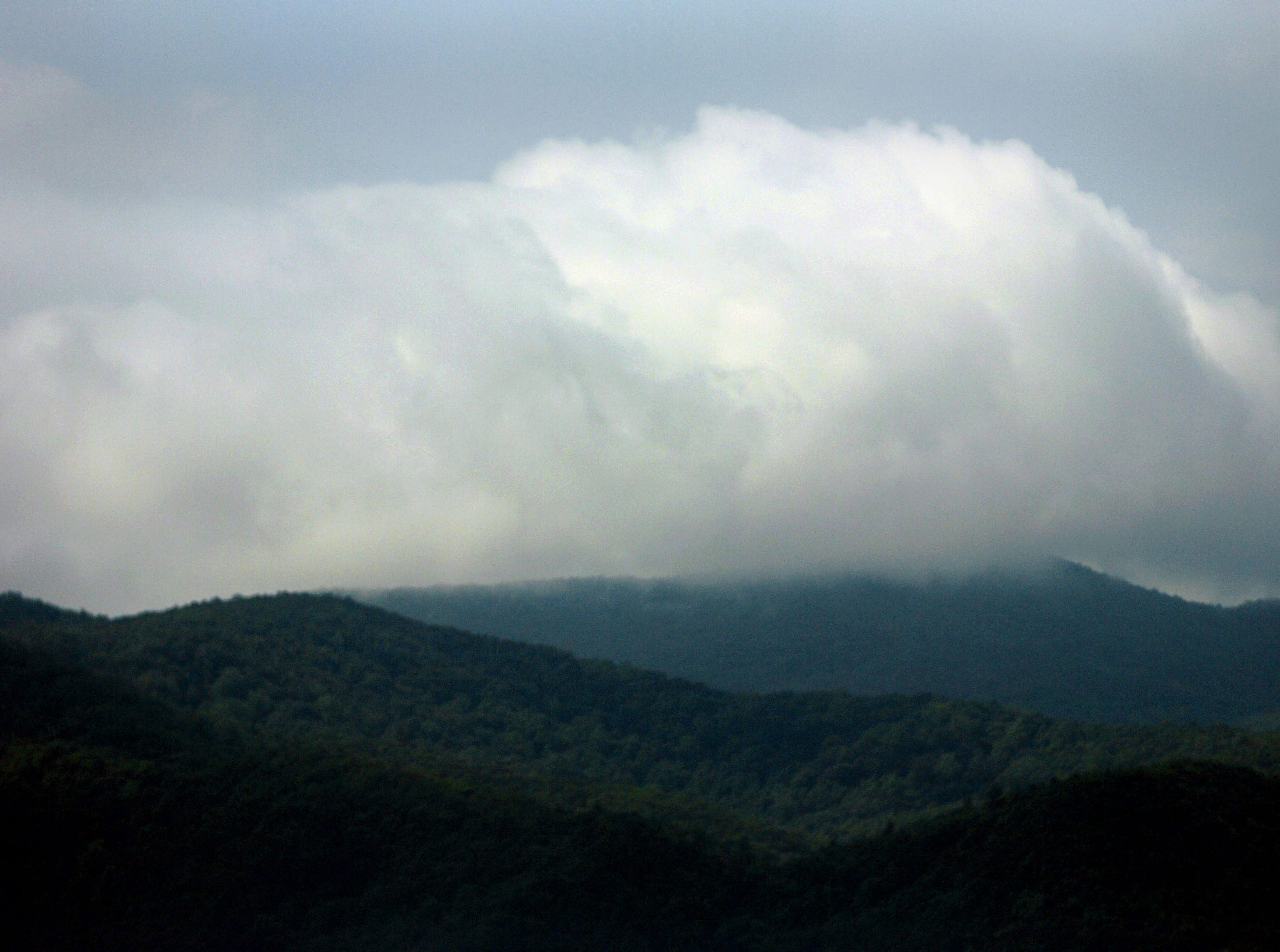 06/28/05  Clouds hang over Cades Cove, which is one of the featured attractions of the Great Smoky Mountain National Park.  It can be easily visited by motorized transportation, but is often congested.  Five alternatives are on the table to lessen traffic problems and range from doing nothing to a mandatory shuttle system.