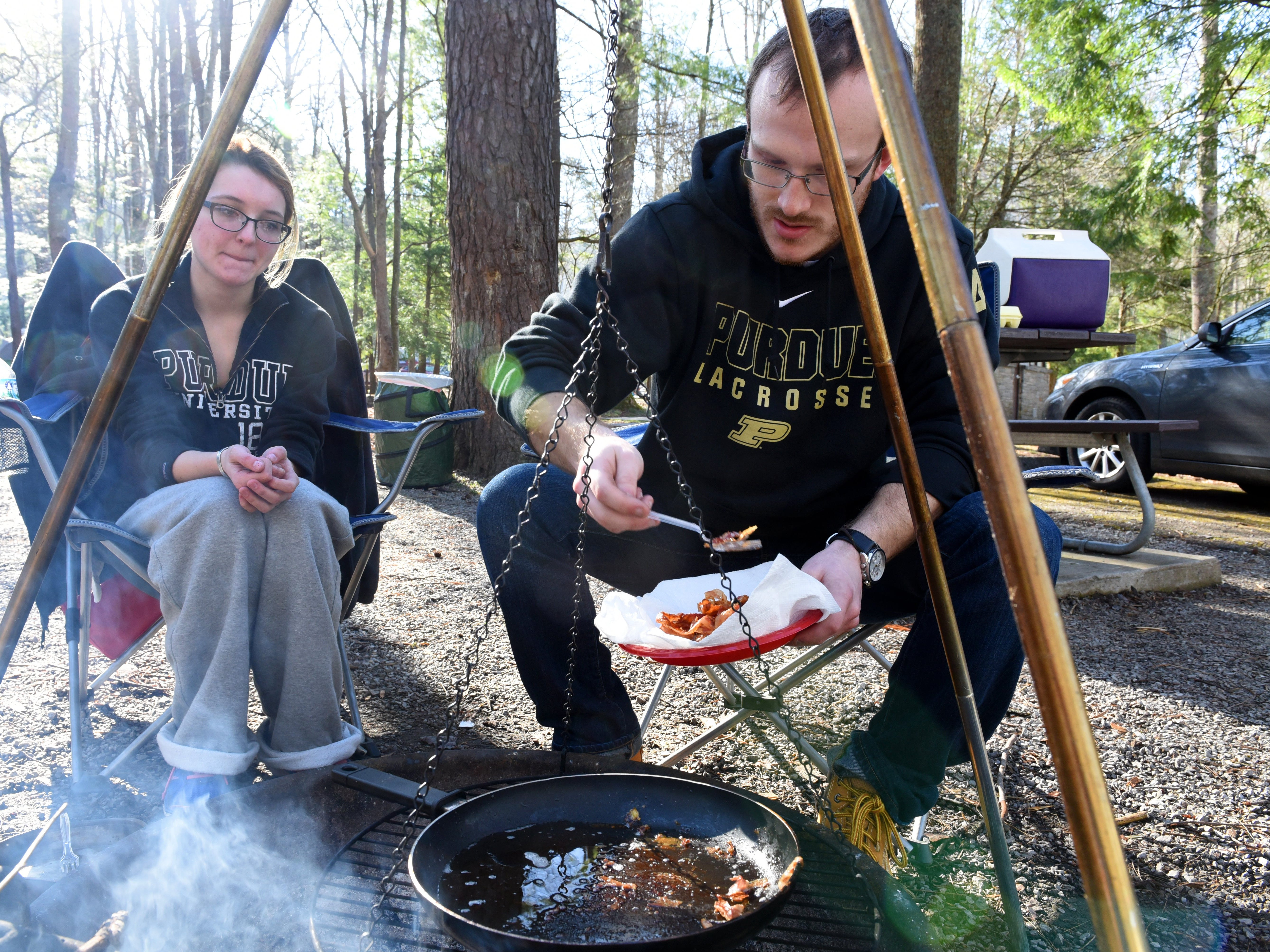 """Conner Noel and Jackie Hall enjoying the last camping space in the Cades Cove campgrounds Tuesday, Mar. 15, 2016. Hall said, """"It's spring break and our first time to the Smoky mountains,"""" said Hall and adding, """"We are here until Friday to enjoy the mountains."""" Great Smoky Mountains National Park announced their opening schedule for 2016.   (MICHAEL PATRICK/NEWS SENTINEL)"""