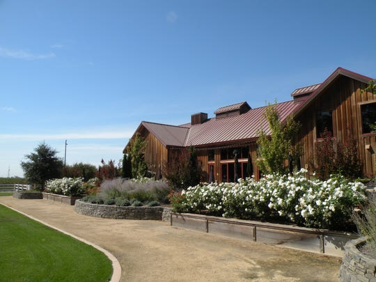One of the most beautiful wine estates in California's Lodi region, Oak Farm Vineyards features an airy visitor center, tasting room, event spaces and winery. Nearby, giant oak trees tower over a Colonial Revival-style house, barn and small lake, surrounded on all sides by vineyards.