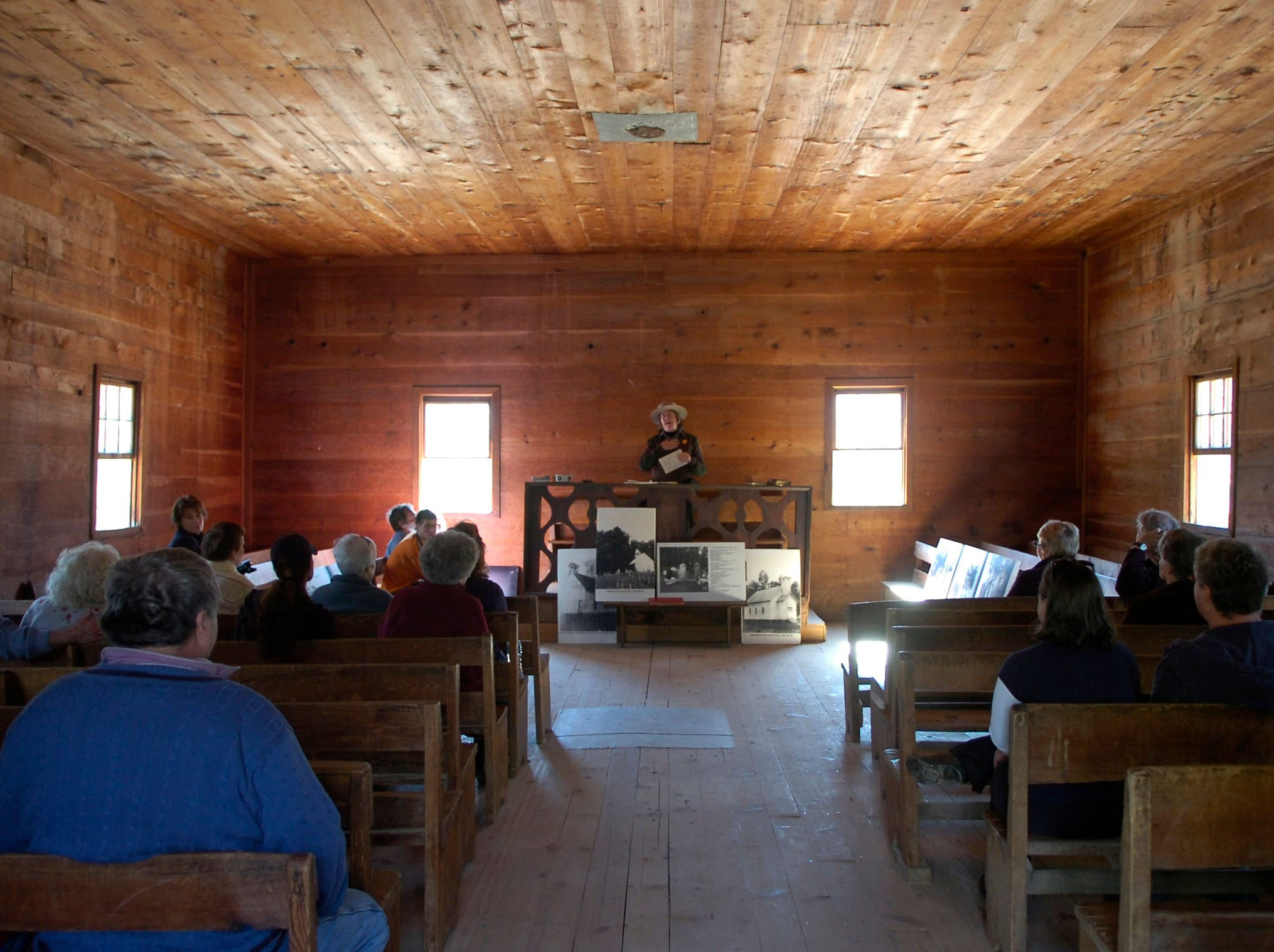 Park ranger Ann Schlichting gives a talk about the cemeteries that exist in Cades Cove at the Great Smoky Mountains National Park. The Tour was part of the Smoky Mountains Winter Heritage Festival.