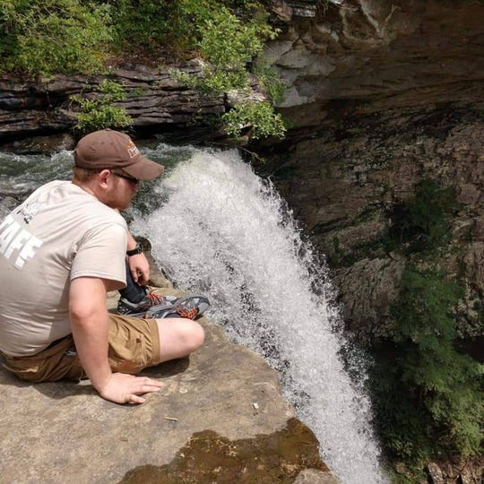 Nathan Davis rests near a waterfall. Nathan died Jan. 13 after a car crash in Maynardville. He loved spending time outdoors and had been trying to lose weight to donate a kidney to his father, according to his family.