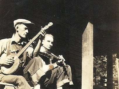 """Vernie Burchfield, left, and Ollie Myers play """"Make Me a Pallet by the Door""""  in Cades Cove in 1928. Myers was blind and could play any instrument put in his hands according to his niece, Verna Myers."""
